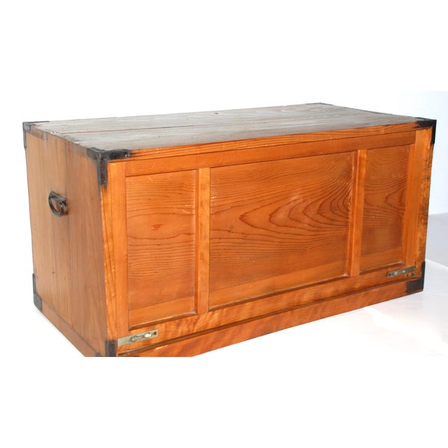 This is a fine Japanese storage box made of kiri wood with iron hardware, early 1900s. A great side table with storage . ....