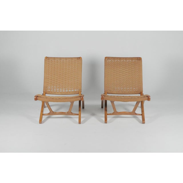 "Organic pair of well made folding slipping chair with a woven seat and backrest. Sleek design with unique ""X"" shaped sides..."