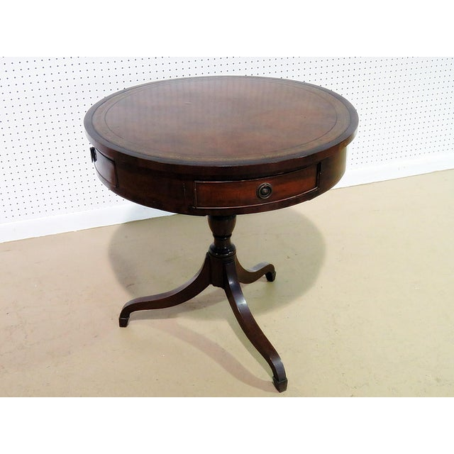 19thC traditional English leather top revolving drum table with 4 drawers.