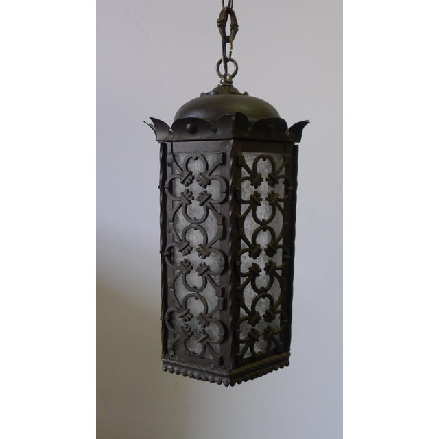 Gothic inspired iron pendant lantern from early 20th Century. Newly electrified, Edison base porcelain socket with an...