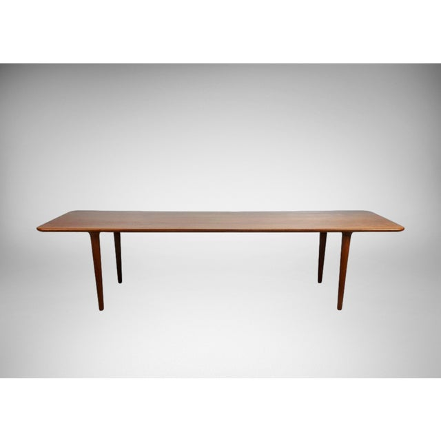Long simple Danish modern teak coffee table, 1960s. Wonderful detail. Fully restored. Excellent condition. See this item...