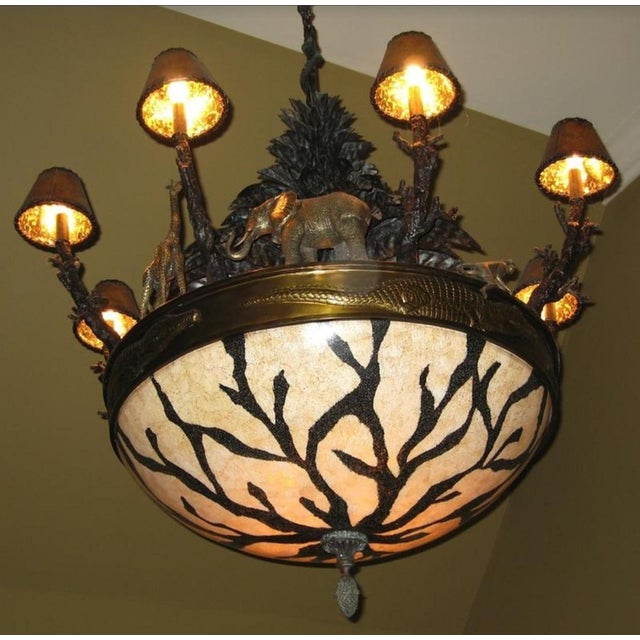 Purchased two of these Verdigris Antique Brass African and Wildlife Chandeliers Shell Bowl, Leather Shades for our African...