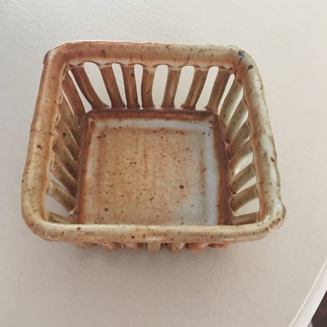 Unique piece of pottery from Michael Cohen pottery. The form resembles a classic produce basket.