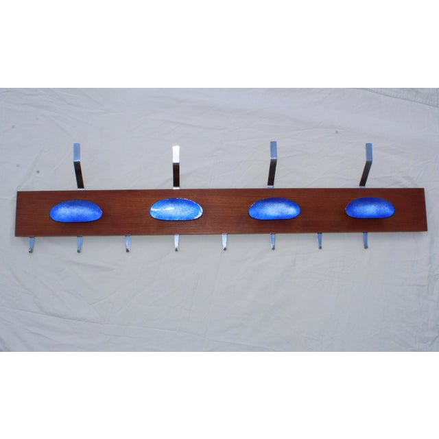 1960s Paolo De Poli attributed wall mounted enamel and chrome on wood coat rack, one end is flat.