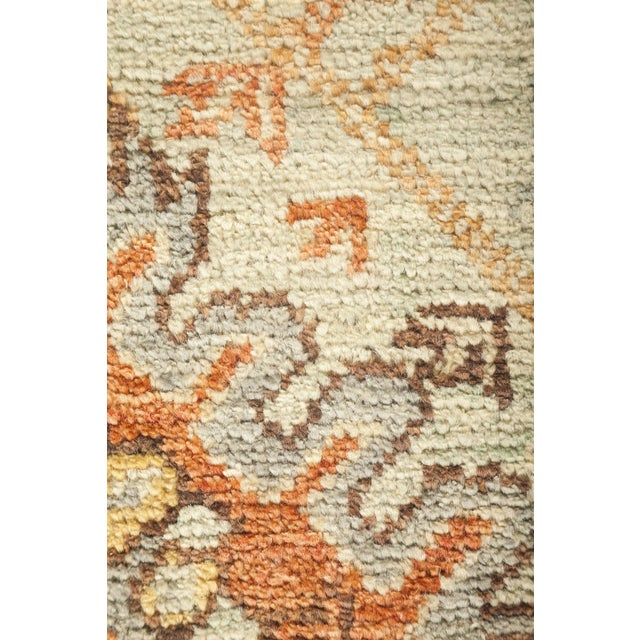 These rugs develop the decorative schemes of late 19th century Turkish carpets. These rugs have large simplified, mostly...