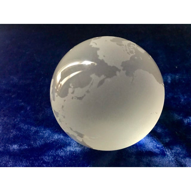 This is a Nice Tiffany & Co. crystal piece, an etched crystal world globe paperweight. Sophisticated accessories for an...
