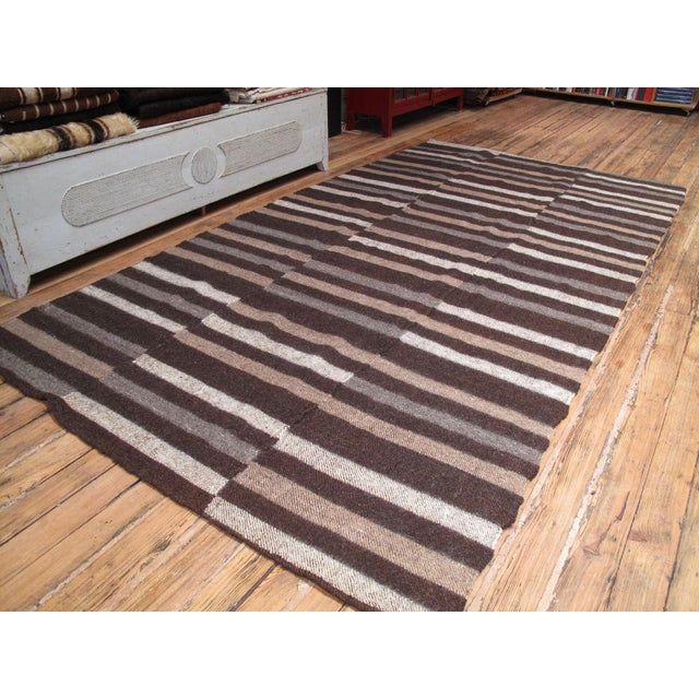 This is a very hefty weaving that feels almost like a felt rug. It is referred to as a blanket but is more suitable as a...