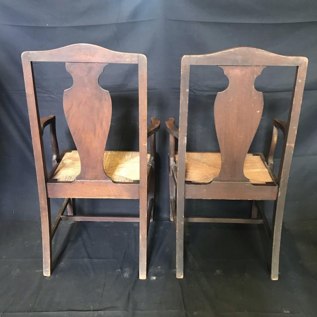 Very handsome set of two early British armchairs in Chippendale style with solid urn-shaped back splats and turned front...