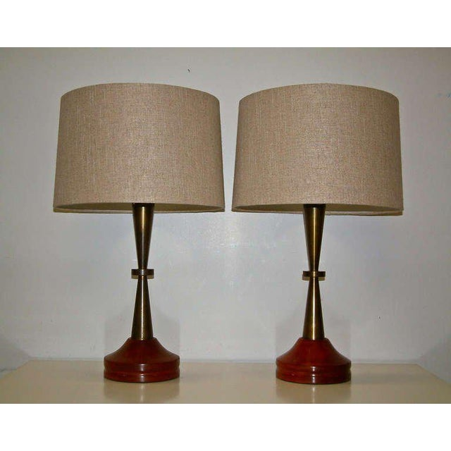 United States Circa 1950 A stunning pair of machined bronze lamps with a primavera wood base with the original patina....