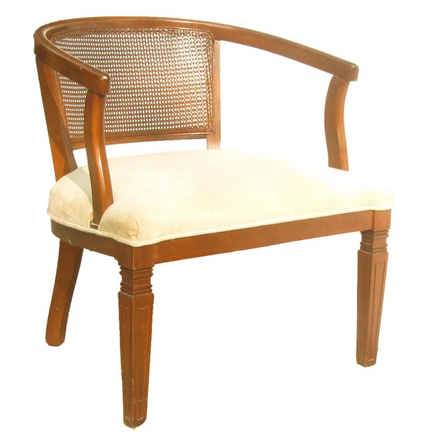 Classic mid-century caned back barrel chair in walnut upholstered with a neutral fabric seat. A lovely accent chair for...