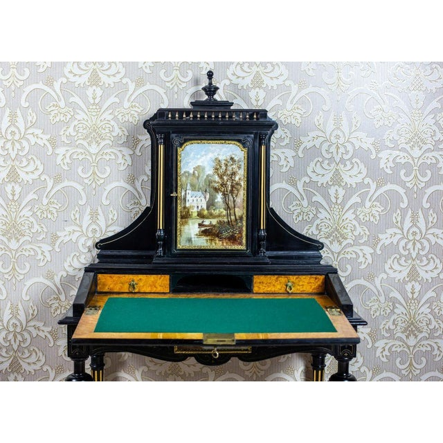 We present you this unique antique piece of furniture, circa 1870; with a lid closed from the front, which forms a writing...
