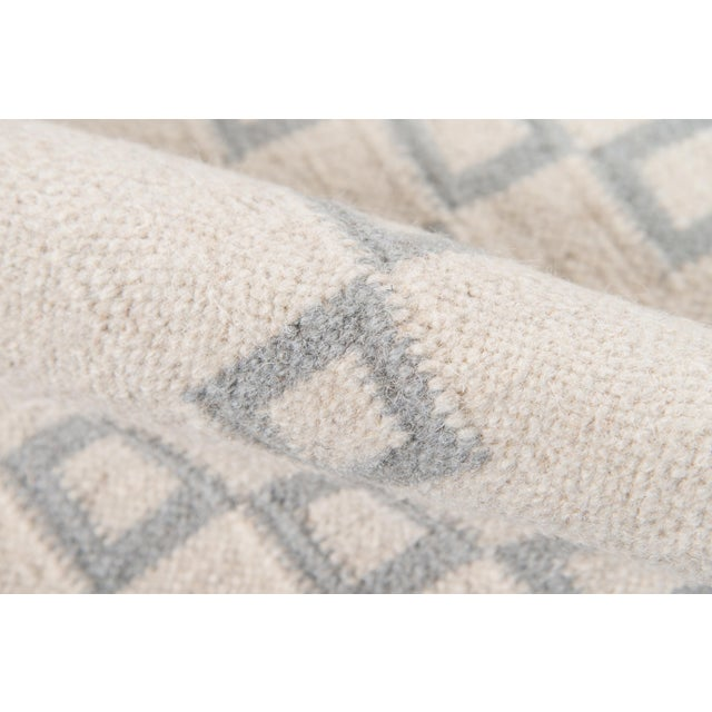 Timeless hand woven carpet techniques enhance the artisanal quality of this decorative area rug. Captured in colors...