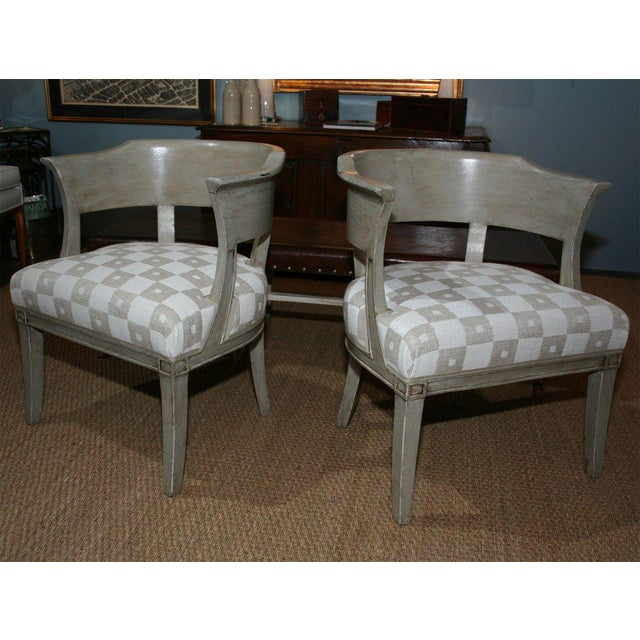 A pair of French painted armchairs with newly upholstered seats and curved, partially open back; from Eze sur Mer,...