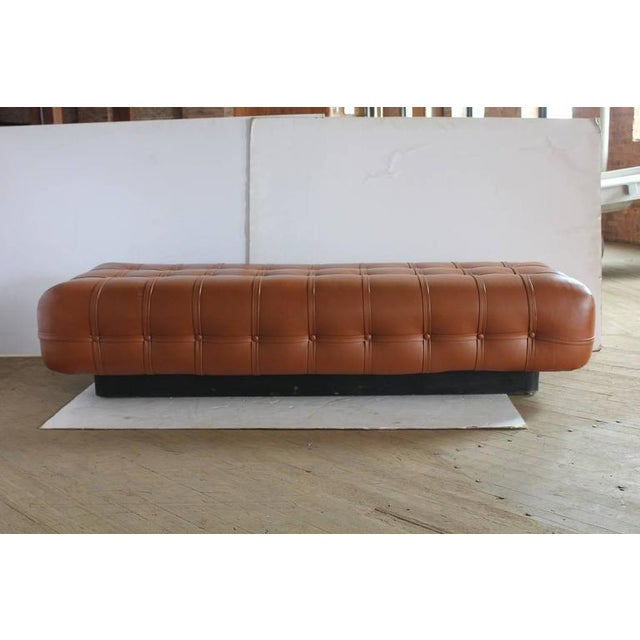 Stylish Mid-Century tufted floating bench by Nicos Zographos for Helikon with wood frame. New leather upholstery.