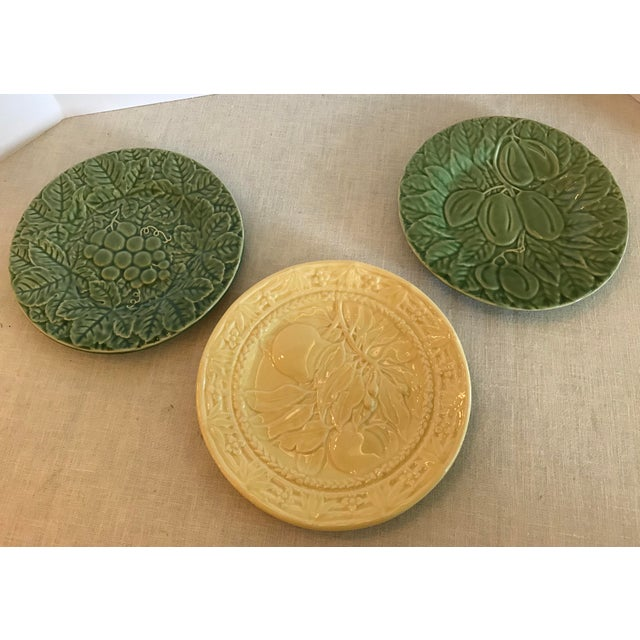 Beautiful vintage set of fruit plates with sculptural raised Design. Two green plates and one yellow. The green plates...