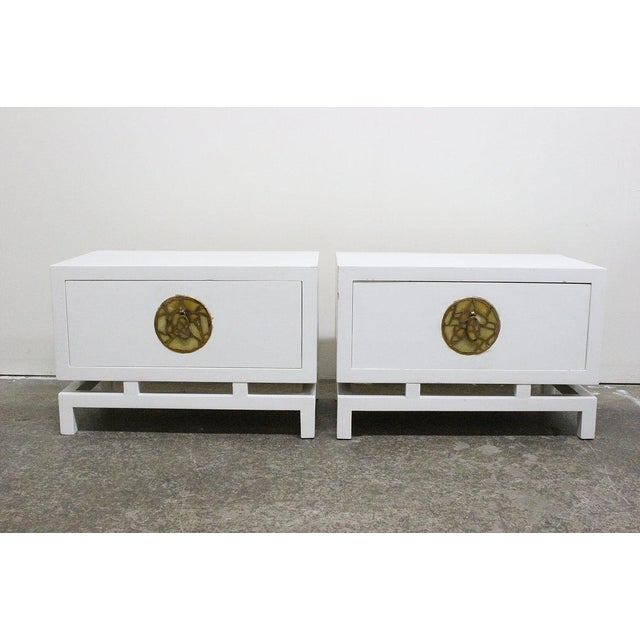 Pair of lacquered nightstands / side tables by Frank Kyle with hardware by Pepe Mendoza. There is visible wear from age...