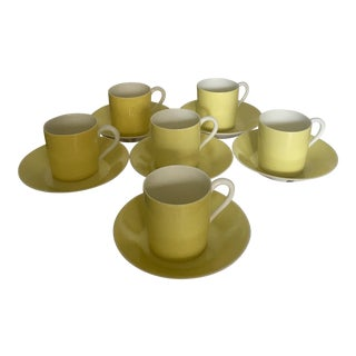 1930s French Limoges Yellow Porcelain Tea Cup and Saucer Set - 12 Pieces For Sale