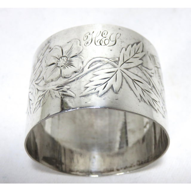 """A very nice Antique sterling silver napkin ring. Hand Engraved Floral decorations with """"K E Y"""". Monograms. Maker's and..."""