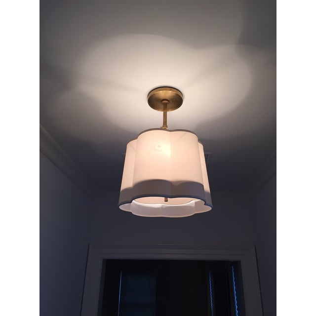 Barbara Berry designed simple scallop pendant from Circa Lighting. This classic Barbara Berry design is a soft brass...