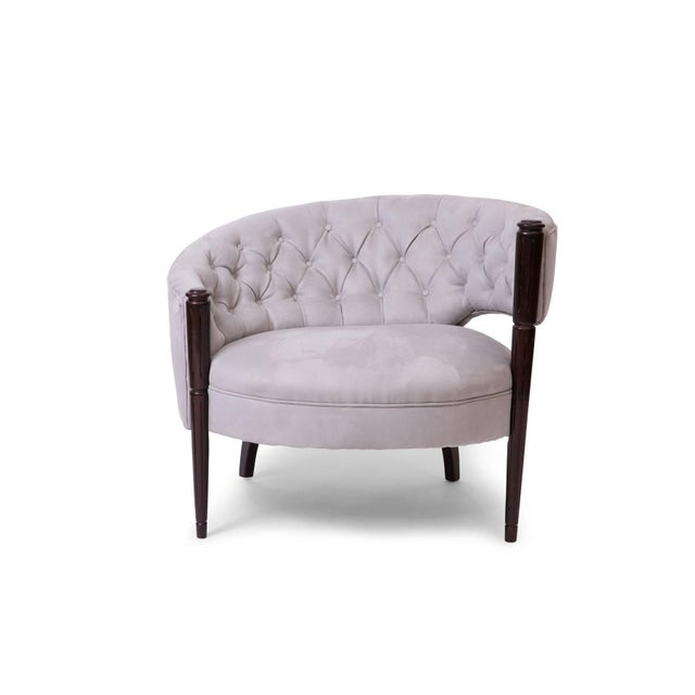 Pair of sculptural 1940s diamond tufted lounge chairs. These examples are mirrored versions of each other and have been...