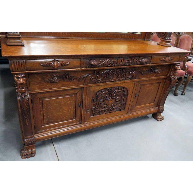 Renaissance style sideboard with four drawers over three doors. The top drawers are lined.