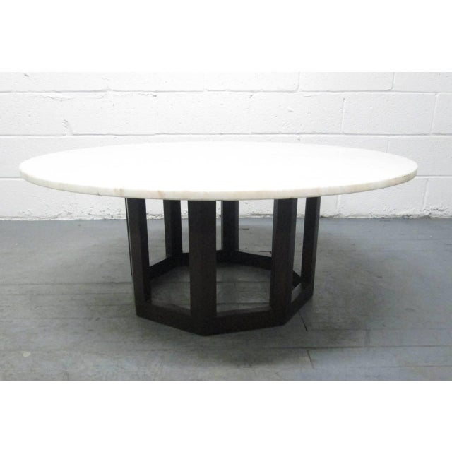 Marble Top Coffee Table. Has a solid walnut sculpted base. Style of Harvey Probber.