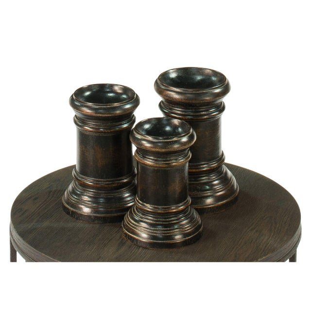 Estimated Retail Price: $255. Trio of decorative bases made of monkey wood. Features acrylic paint and wax finish.