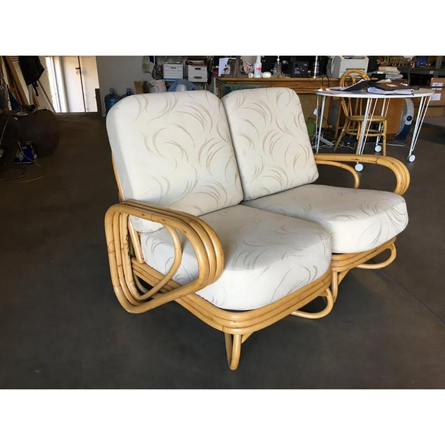 "Rare ""Triple Triangle"" arm rattan 2 seater sectional loveseat featuring arch looped base. Measures: Sofa: 33in. H x 73in...."