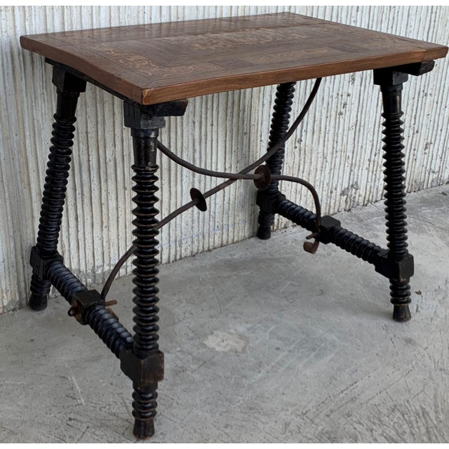 About 19th century Baroque Spanish side table with marquetry top 19th century Spanish trestle table in walnut. This piece...