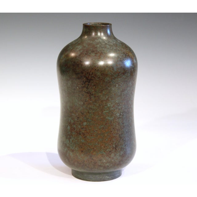 Good vintage Japanese bronze bottle vase in dark finish with greens, browns, blues, and reds. Circa early/mid 20th...