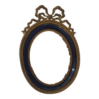 Antique Brass Ribbon and Bow Frame For Sale