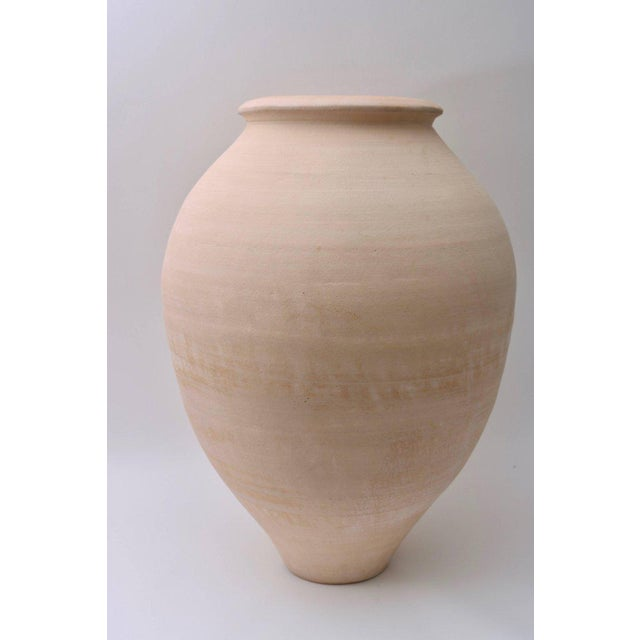 These artisan earthen ware vases are in the classic amphora shape of the Mediterranean and were created in 1985. The will...
