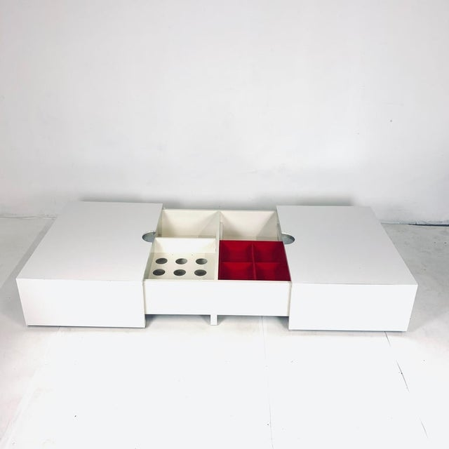 Fantastic 1970s convertible coffee table. This unique piece slides open on both ends to reveal hidden storage for bar...