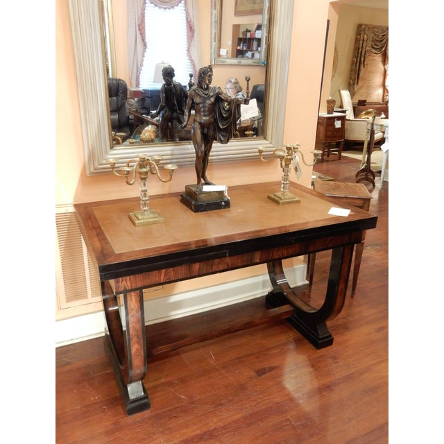 An exceptional Art Deco table that extends on both sides and has a leather top. It can function as a console table,...
