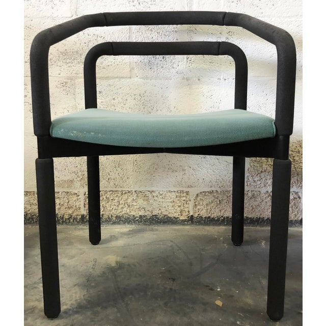 Set of six polyurethane foam covered black chairs by Metropolitan Furniture Corporation. Metropolitan was founded in 1905...