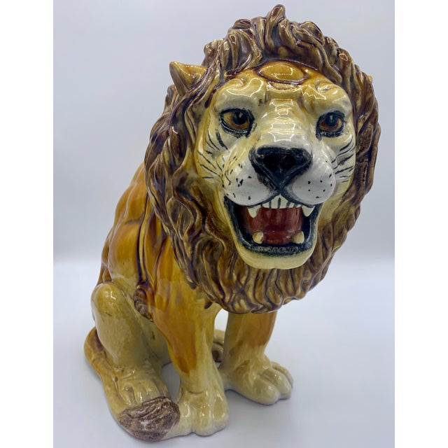 Large Italian Majolica Terracotta Roaring Lion Statue. This Italian lion has a beautiful lustrous glaze, fine detail, and...
