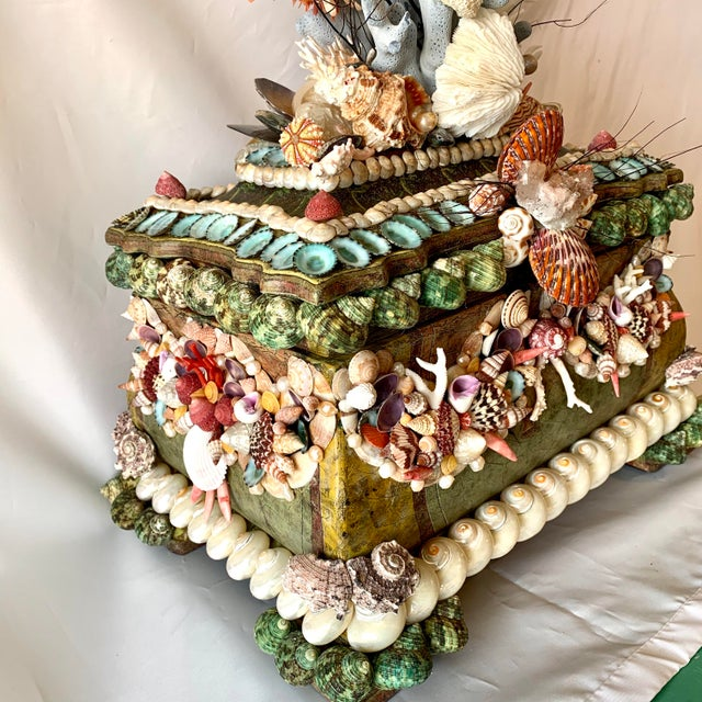Large Seashell, Pearl and Gem-encrusted chest. This chest has decorated garlands on all four sides with beautiful shells...