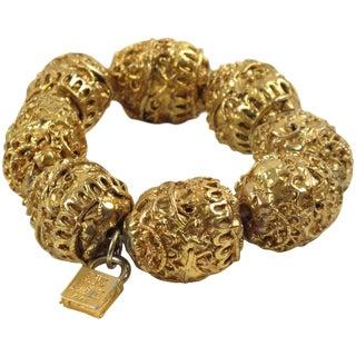 French Designer Alexis Lahellec Paris Signed Stretch Bracelet Gilt Carved Beads For Sale