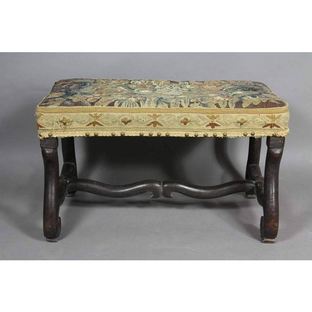 Rectangular with Aubusson tapestry seat raised on curved legs with conforming stretcher, scroll feet.