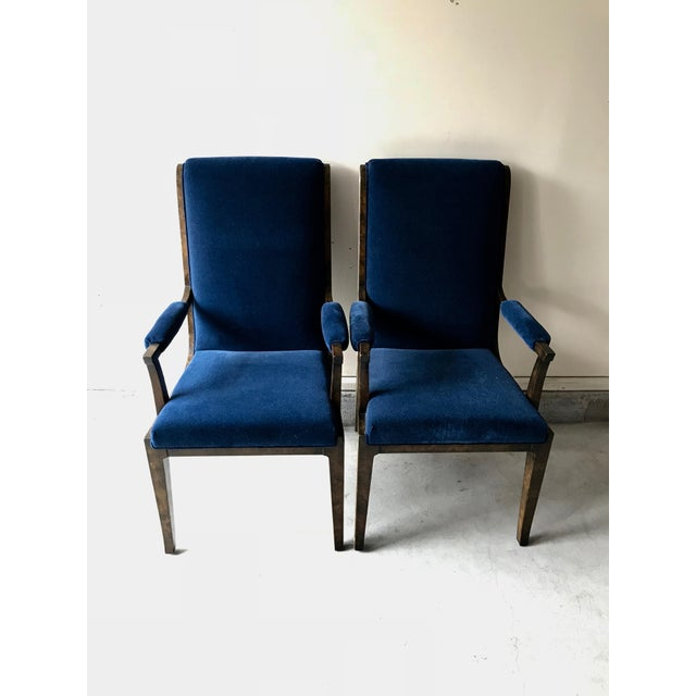 Reupholstered with blue velvet, these vintage dining chairs are have detailed burled wood and outlined with silver metal...