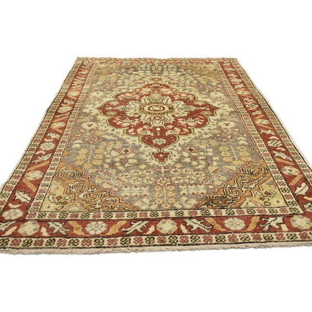 This hand-knotted wool vintage Turkish Sivas accent rug features a modern rustic style. Immersed in Anatolian history and...