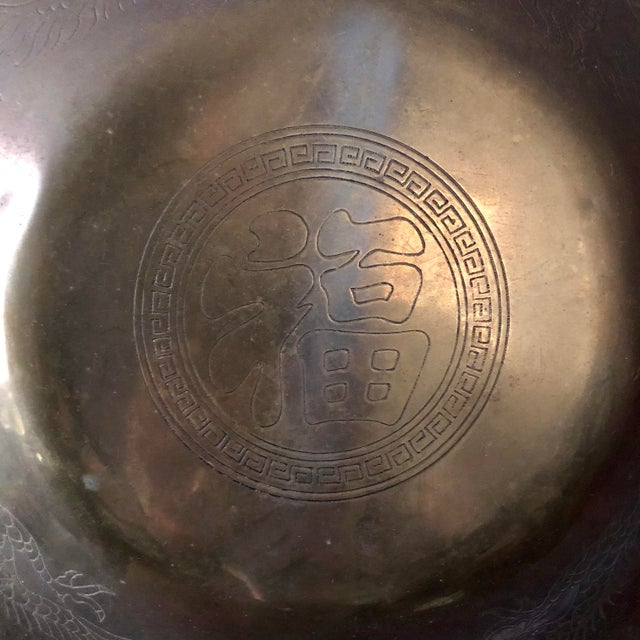 Vintage brass gong with Chinese character at center and two dragons.