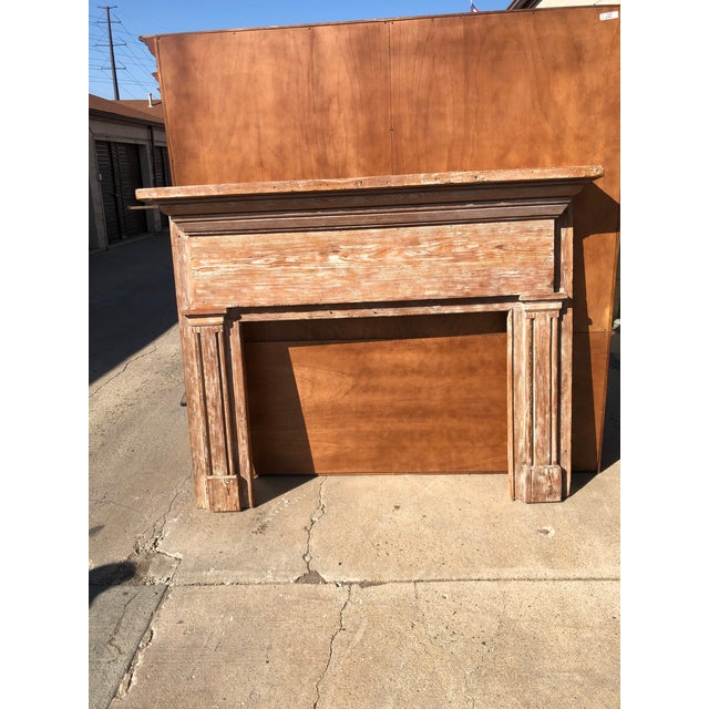 Antique wooden mantle made of oak. Light white stain. Features typical fireplace mantel elements such at faux columns or...