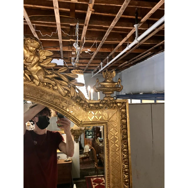 Nothing sparkles like parcel gilt, and this monumental Napoleon III mirror is no exception, what tales would it tell of...