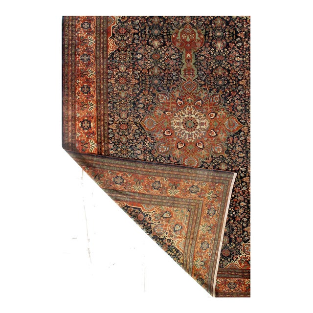 hand-knotted antique Sarouk Farahan rug. The piece was made from hand-spun lamb's wool and all-natural dyes. Circa 1880....