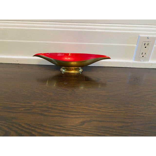 Elegant and pretty brass and enamel footed candy dish. Color is a gorgeous shade of red.
