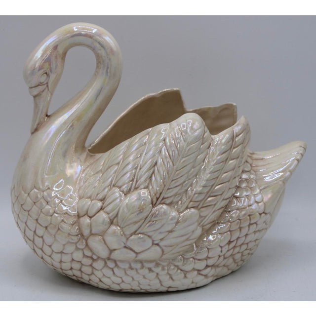 This is a cream lusterware swan cachepot or planter, made in Holland. This is a detailed piece, in excellent condition...