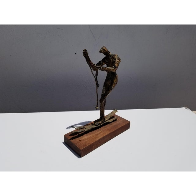 Vintage mid-century modern figural abstract of a man skiing on ice. Brutalist art torch copper on solid mahogany base...