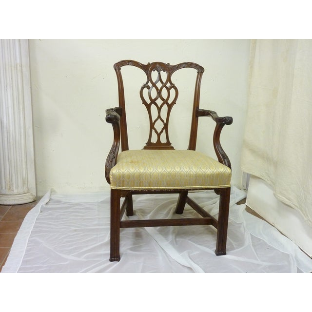 18th Century English Chinese Chippendale mahogany armchair with reeded legs, carved arms and back, upholstered seat,...