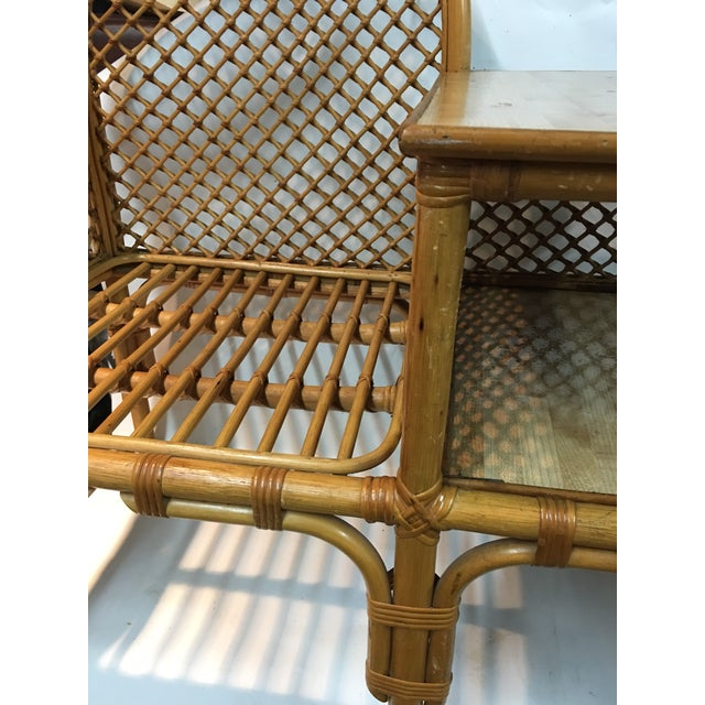 Rare vintage 1970s wicker and bamboo waiting room chair with table attached. Excellent vintage condition, some stains and...